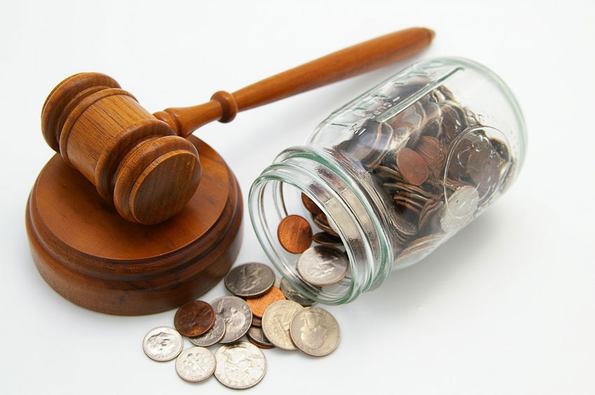 Holsinger Law Office - What is a General Practice Attorney - a gavel with a jar of coins.