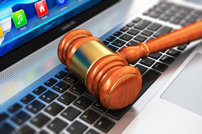 Holsinger Law - The Remote Practice of Law and the Client - A gavel on a laptop